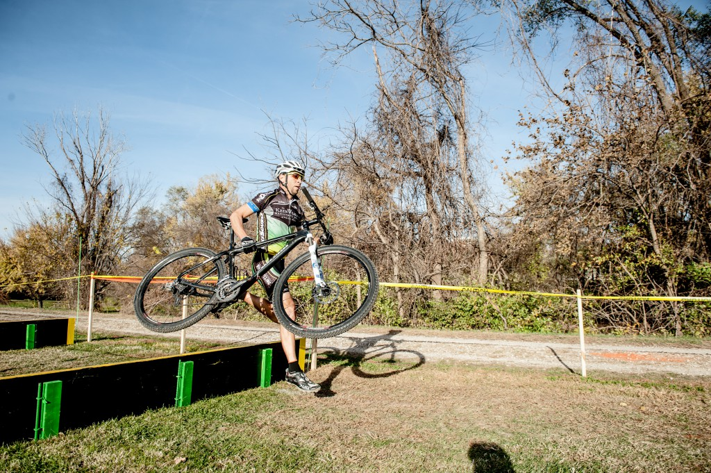 Greg Vaught had to see a chiropractor after lifting his mountain bike over this obstacle.