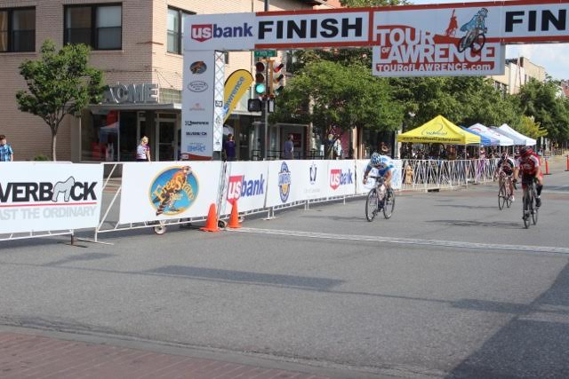 Jay battles through the headwind and throws his bike for second place.