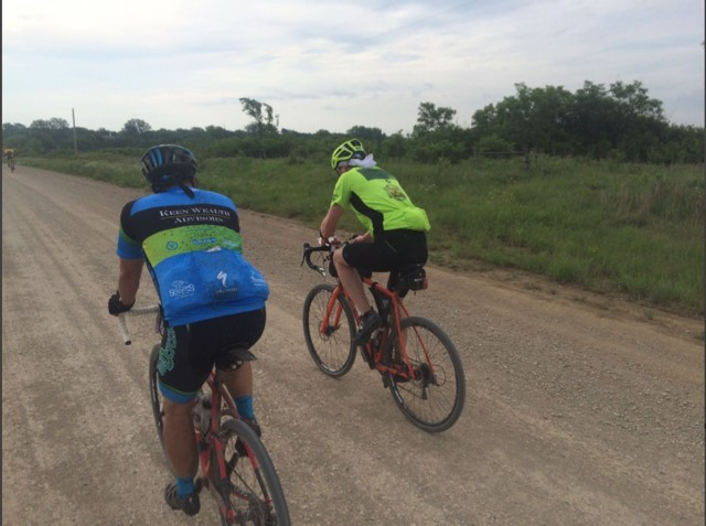 Sam Hess grinding the 50-mile course with another rider he met along the way.